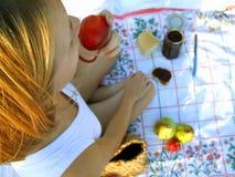 Girl having breakfast royalty free stock image