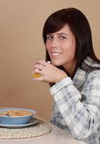 Girl having breakfast Stock Photos
