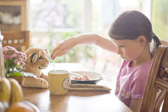 Girl having a breakfast Stock Image