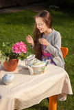 Girl having breakfast at yard and laughing loud Stock Image