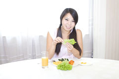 A girl having breakfirst Royalty Free Stock Images
