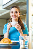 Girl having a coffee break with cappuccino Royalty Free Stock Photo