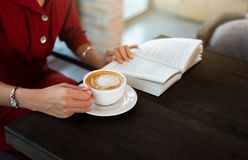 Free Girl Having Coffee In The Bar And Reading Stock Photography - 146285262