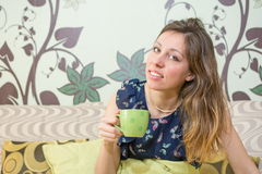 Girl having cup of coffee at home Royalty Free Stock Photo