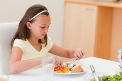 Girl having dinner at the table Royalty Free Stock Photography
