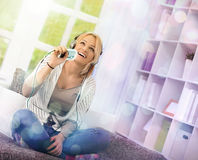 Girl having a enjoyable time while listening the music Royalty Free Stock Photos