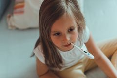 Girl is having flu. Little girl is having temperature because of flu royalty free stock photo