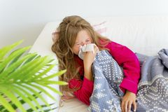 Girl having flu. A portrait of an ill girl having flu at home royalty free stock image
