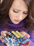 Girl having flu taking pills Royalty Free Stock Images