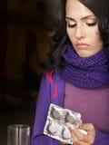 Girl having flu taking pills Royalty Free Stock Photos