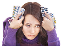 Girl having flu taking pills Stock Photography