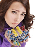 Girl having flu taking pills. Young woman having flu takes pills Royalty Free Stock Photo