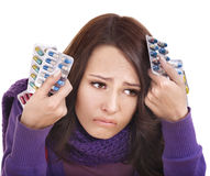 Girl having flu taking pills Royalty Free Stock Photos