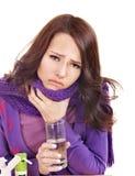 Girl having flu taking pills. Young woman having flu takes pills Royalty Free Stock Image