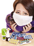 Girl having flu taking pills Stock Photos