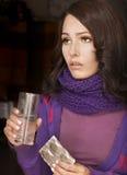Girl having flu taking pills Royalty Free Stock Images