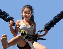 Girl having fun. Girl having a good time bungee jumping Stock Photography