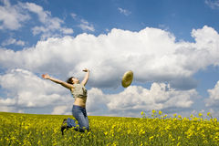 Girl having fun. In summer rape field Stock Image