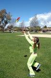Girl having fun. Girl playing in park royalty free stock photo