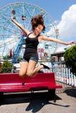 Girl having fun in amusement park royalty free stock photos