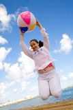 Girl having fun at the beach Stock Photography
