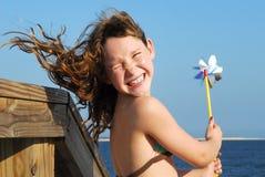 Girl having fun at beach Stock Image
