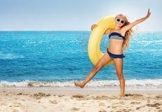 Girl having fun on beach during summer vacation Stock Photos