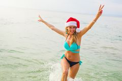 Girl having fun on the beach during winter holidays stock photography
