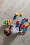 girl having fun and build of bright plastic construction blocks royalty free stock photo
