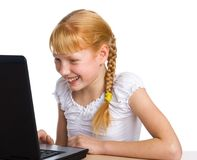Girl having fun with computer game Royalty Free Stock Photography