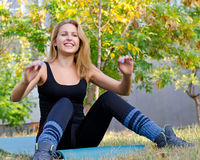 Girl having fun exercising outdoors Stock Photography