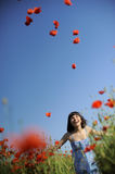Girl having fun in a field with poppies Stock Image