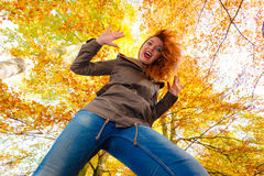 Girl having fun in forest. Stock Photography