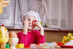 Girl having fun with form for cookies in kitchen Royalty Free Stock Photo