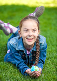 Girl having fun on grass and holding globe Royalty Free Stock Images