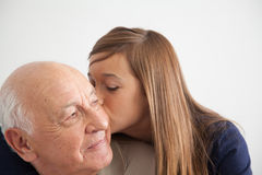 Girl having fun with her grandfather Stock Photography