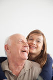Girl having fun with her grandfather Royalty Free Stock Image