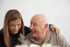 Girl having fun with her grandfather Stock Photos