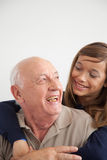 Girl having fun with her grandfather Stock Image