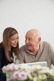 Girl having fun with her grandfather Stock Photos