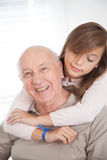 Girl having fun with her grandfather Stock Images