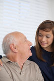 Girl having fun with her grandfather Royalty Free Stock Images