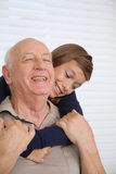 Girl having fun with her grandfather Royalty Free Stock Photos