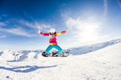 Girl having fun on her snowboard Royalty Free Stock Photo
