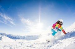 Girl having fun on her snowboard Royalty Free Stock Photo