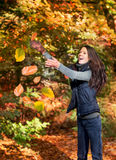 Woman catching leaves Royalty Free Stock Photography