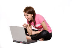 Girl having fun online using laptop Royalty Free Stock Photo