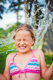 Girl having fun outdoor with water Royalty Free Stock Images