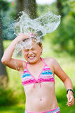 Girl having fun outdoor with water Stock Photo