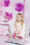 Girl having fun at pink decirated birthday party Royalty Free Stock Image